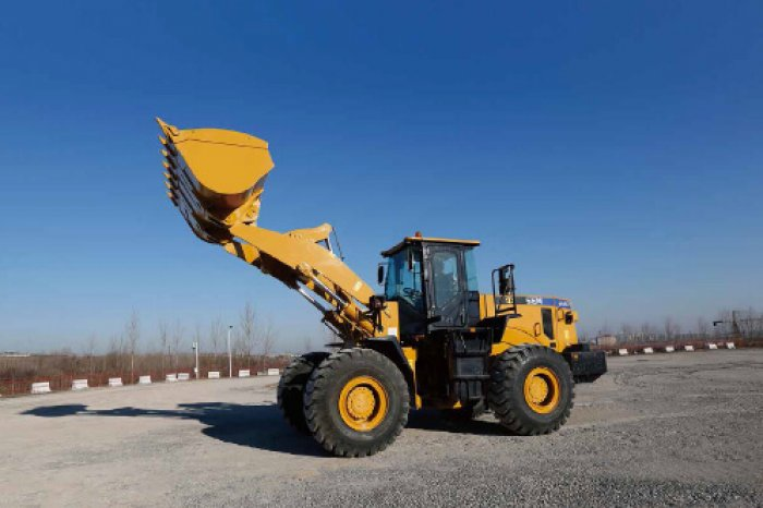 sem wheel loader 655d with lifted bucket
